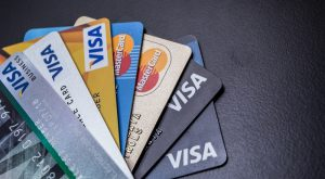 Visa CEO Plays Down Cryptocurrency Threat, Indicates Possible Intervention